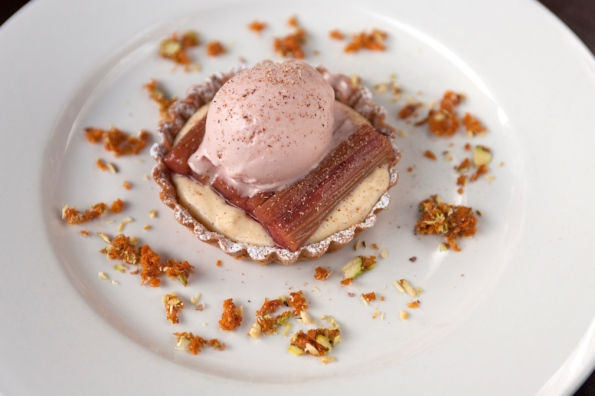 rhubarb and custard tartlet with strawberry ice-cream, nutmeg and pistachio brittle