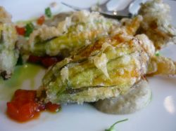 Zucchini flowers stuffed with ricotta and parmesan, smoked eggplant puree and red capsicum.