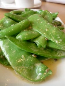Spring greens with anchovy butter
