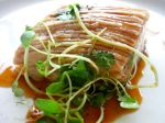 Slow roasted belly of Bangalow sweet pork, pear puree, cress salad, grape sauce.